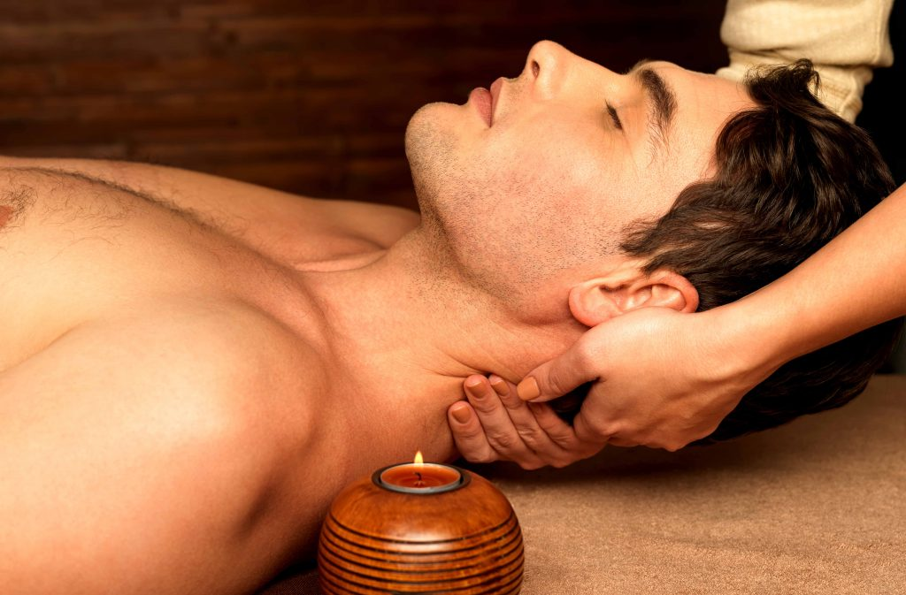 Man having neck massage in the spa salon